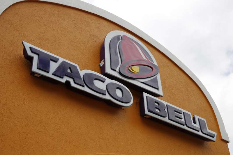 The sign at a Taco Bell in Mount Lebanon, Pa. Taco Bell is starting delivery service on Wednesday, July 8, 2015, in certain markets in a partnership with the startup delivery company DoorDash.