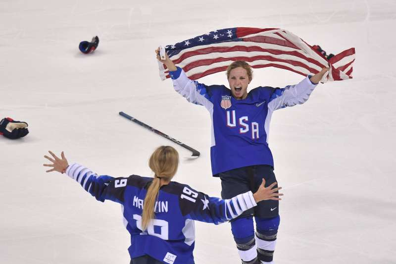 Team USA celebrates winning after a penalty shootout in the women's gold medal ice hockey match between Canada and the US during the Pyeongchang 2018 Winter Olympic Games at the Gangneung Hockey Centre in Gangneung on February 22, 2018.