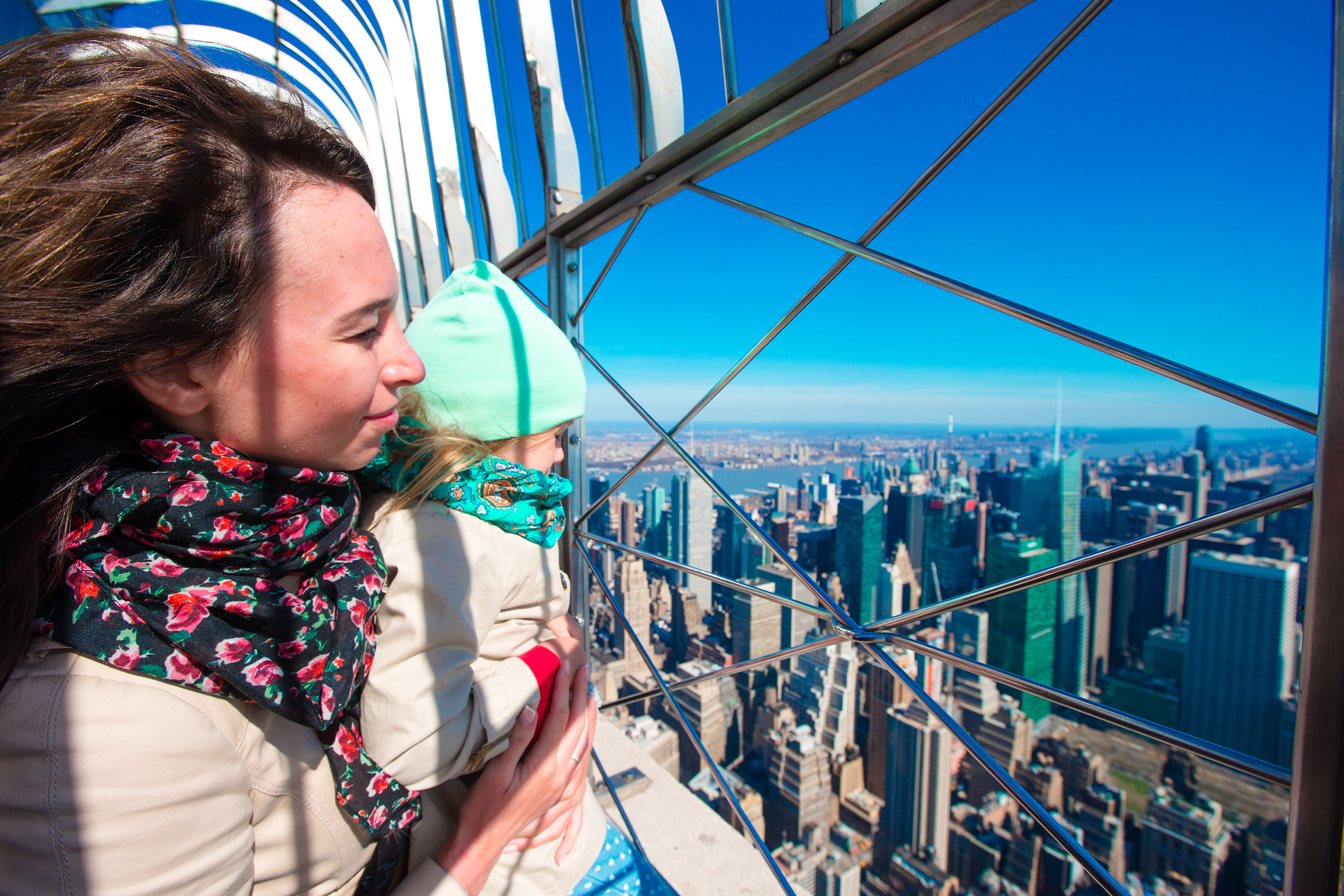 A family enjoys the view of New York City from the Empire State Building