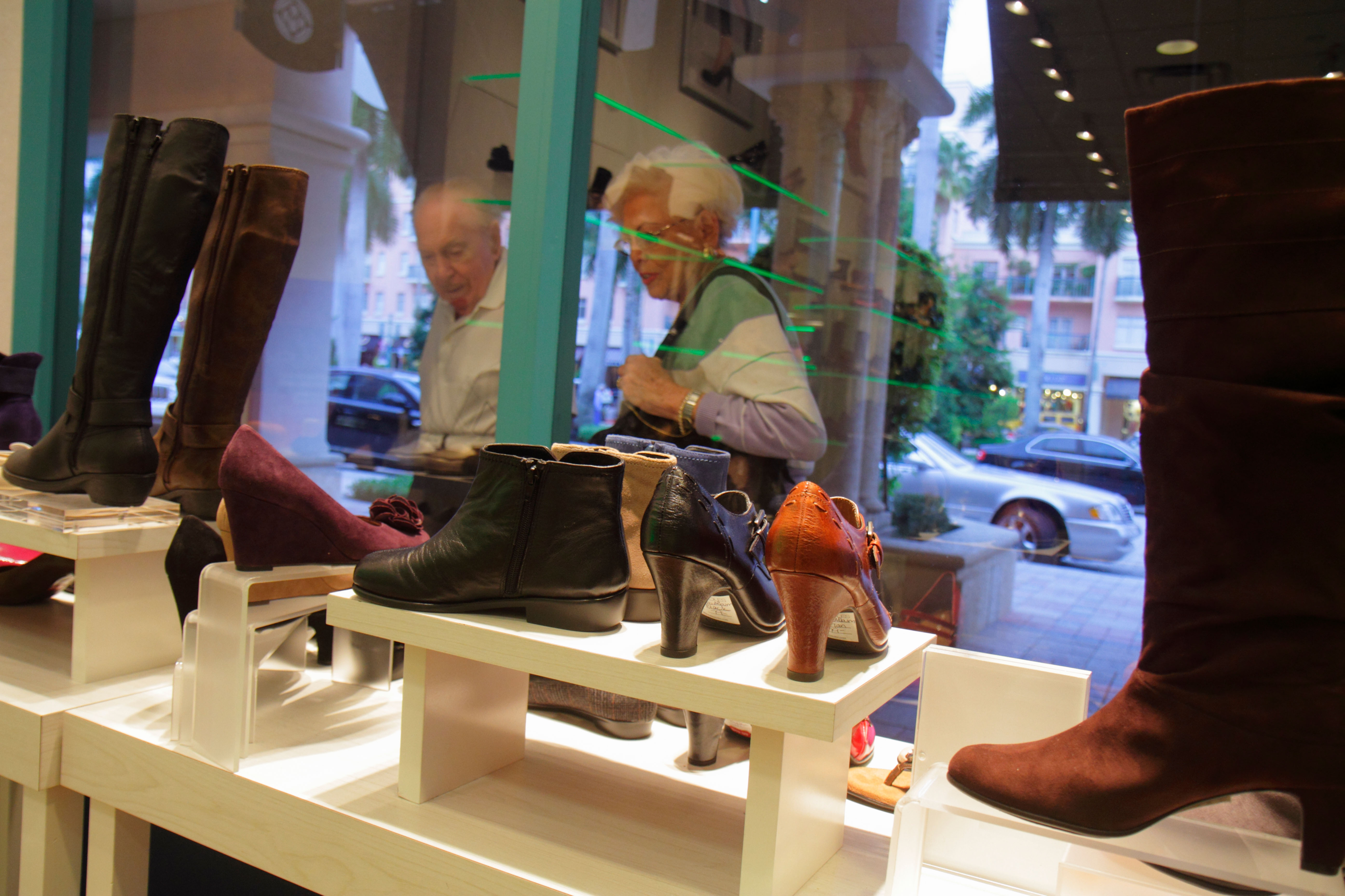 Boca Raton Florida Mizner Park Plaza Real shopping retail display for sale Aerosoles shoes women's comfort suede boots senior ma