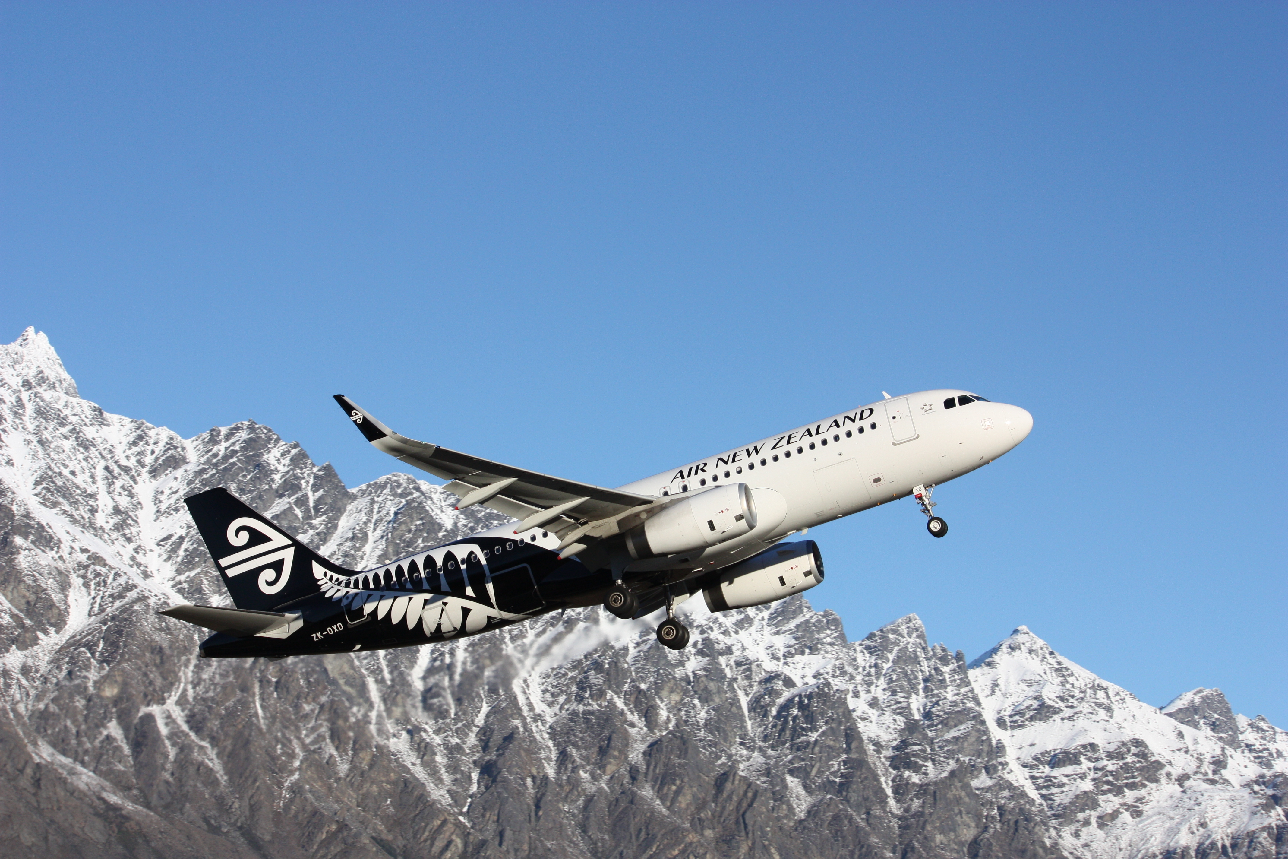Airplane Air New Zealand take-off from Queenstown, August 16, 2014.