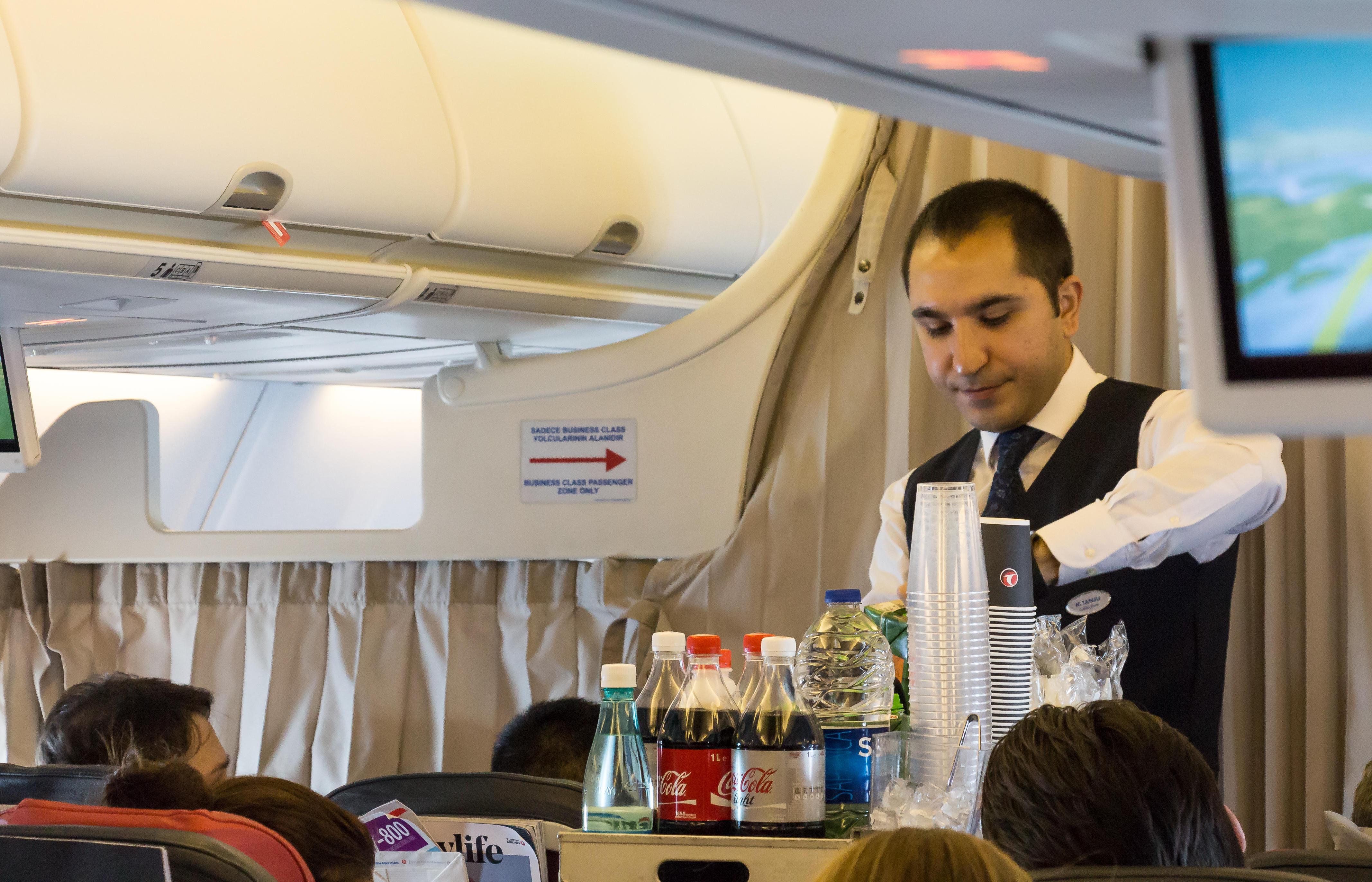 Flight attendant serving breakfast onboard a Boeing 737, Turkish Airlines. Tokyo, Japan, April 8, 2017.