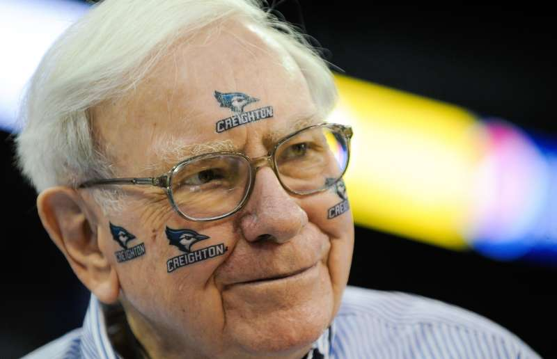 Warren Buffett of Berkshire Hathaway poses for pictures before the game between the Creighton Bluejays and the Providence Friars at CenturyLink Center on March 8, 2014 in Omaha, Neb.
