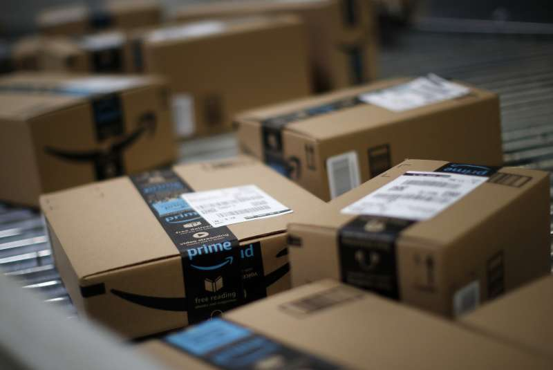 Boxes move along a conveyor belt at the Amazon.com fulfillment center in Kenosha, Wisconsin, U.S., on Tuesday, Aug. 1, 2017. Amazon.com Inc. held a giant job fair at nearly a dozen U.S. warehouses as part of its effort to hire 100,000 people in the U.S. by 2018. Photographer: Jim Young/Bloomberg via Getty Images