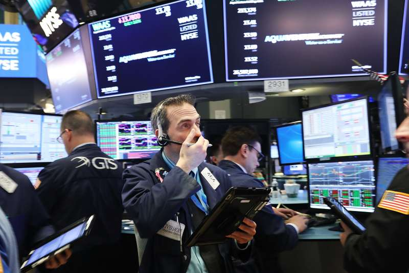 Traders work on the floor of the New York Stock Exchange (