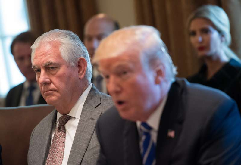 Secretary of State Rex Tillerson listens as President Donald Trump speaks during a cabinet meeting at the White House on November 20, 2017.
