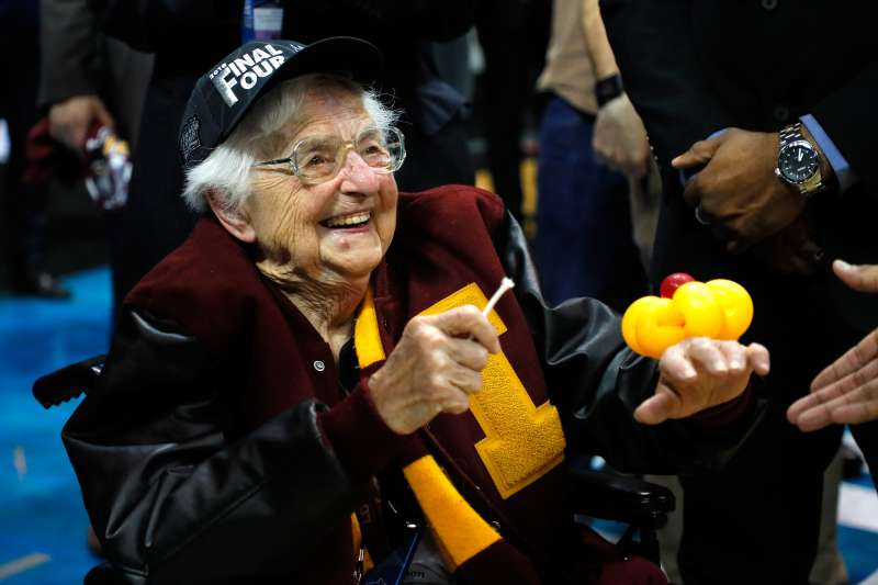 Sister Jean Dolores Schmidt celebrates with the Loyola-Chicago Ramblers after defeating Kansas State during the 2018 NCAA Men's Basketball March Madness Tournament.