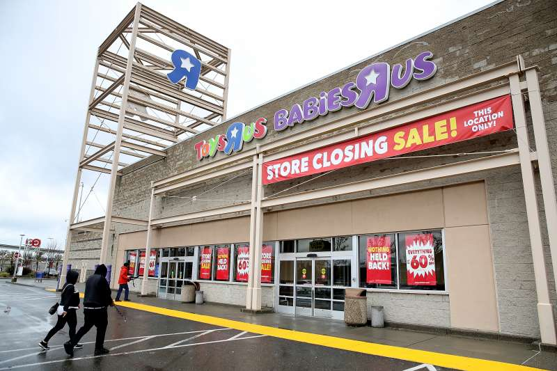Customers enter a Toys R Us store on March 15, 2018 in Emeryville, California.