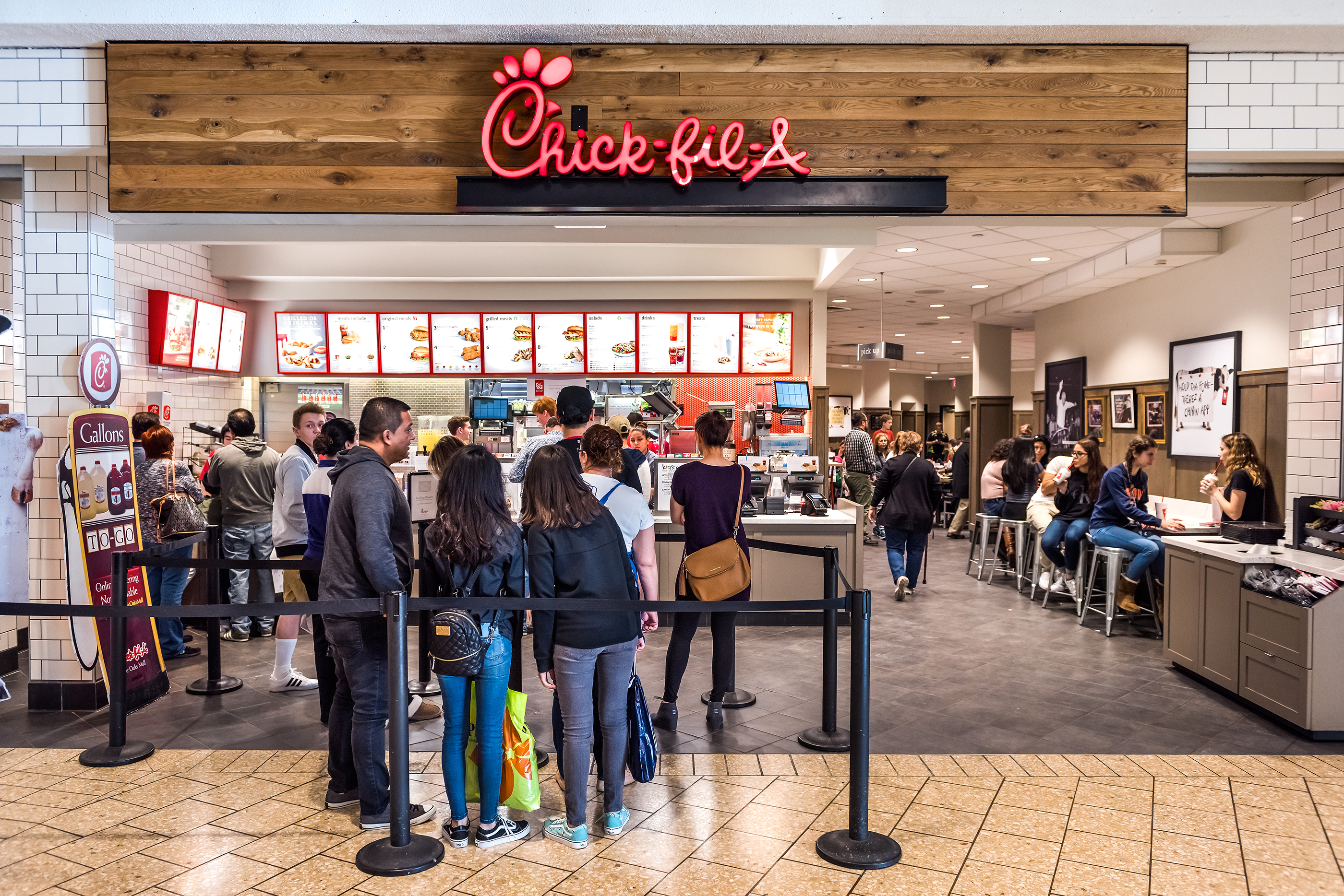 Chick-fil-a store with people in line waiting to buy food, Fairfax, Virginia, Feburary 18, 2017.