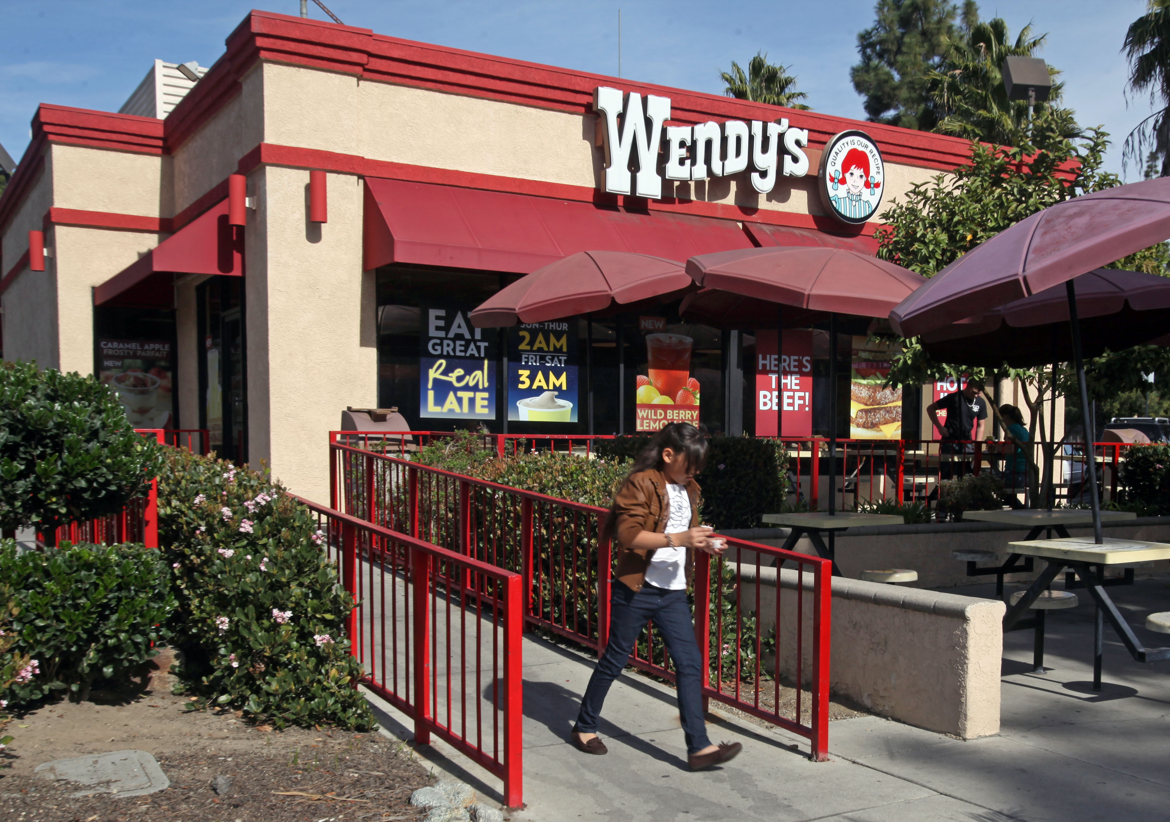 A customer leaves a Wendy's restaurant in Los Angeles.