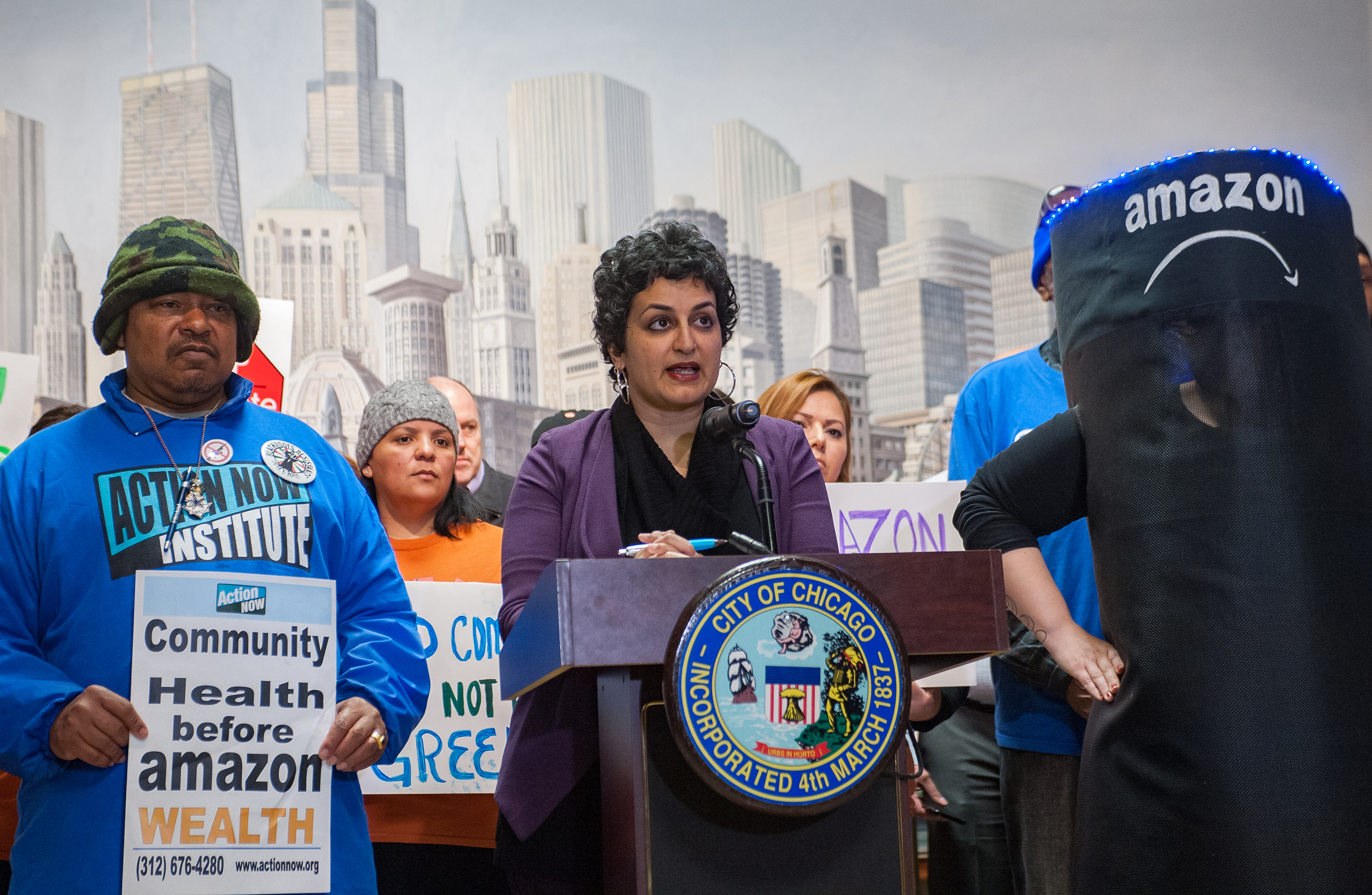 Amisha Patel, Executive Director of Grassroots Collaborative addresses crowd at Press Conference in Chicago City Hall, April 11, 2018.