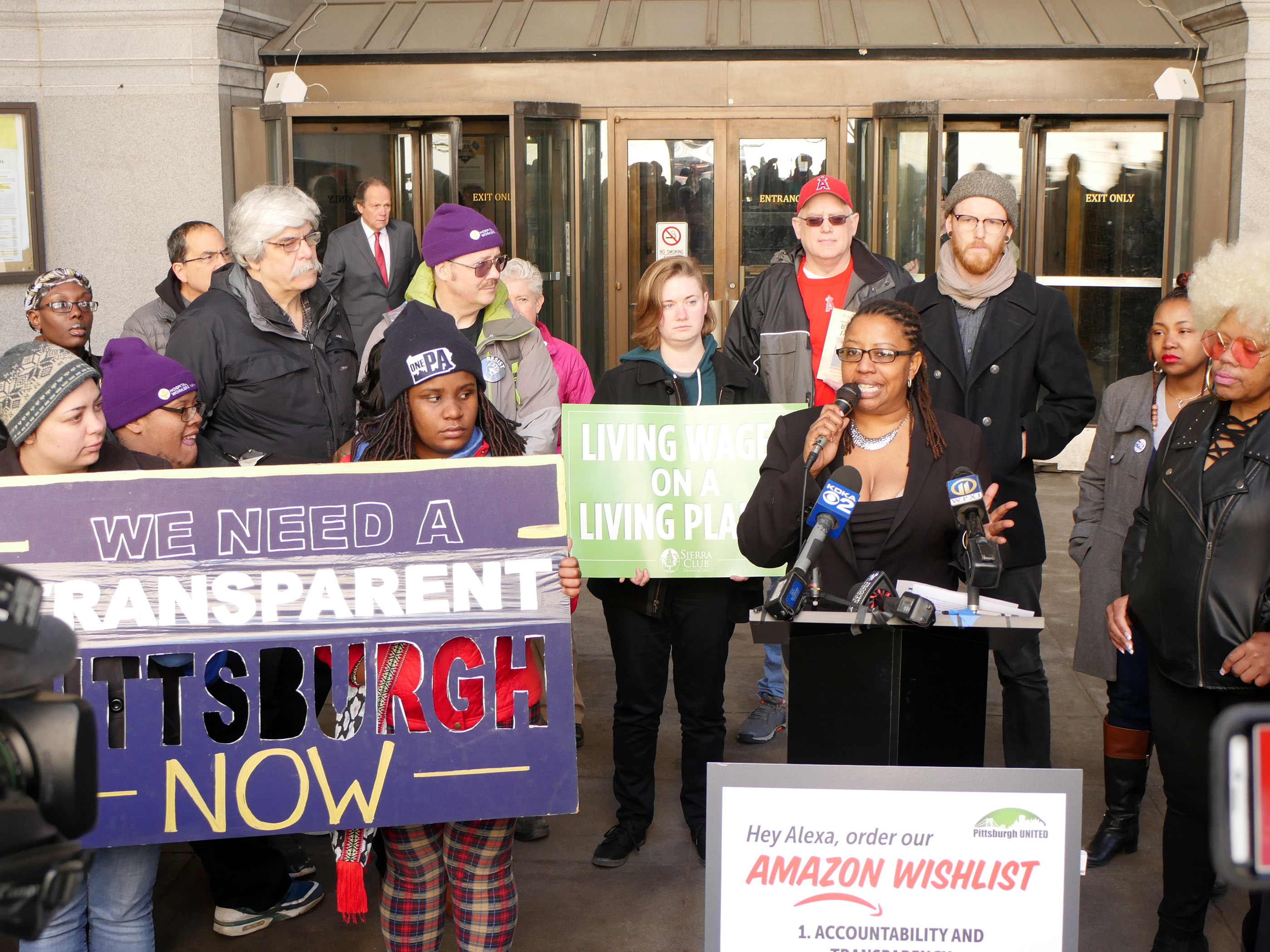 Brandi Fisher of Pittsburgh United speaks at a rally demanding more transparency in HQ2 bid, April 11, 2018.
