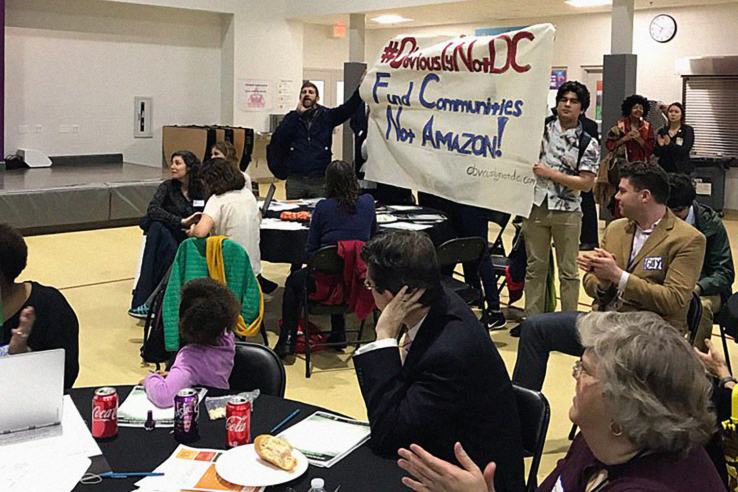 Residents are challenging Mayor Bowser to fund communities, housing, schools and transit, not give away our money to the worlds richest man and Amazon, Watkins Field Recreation Center, Washington, D.C., February 22, 2018.