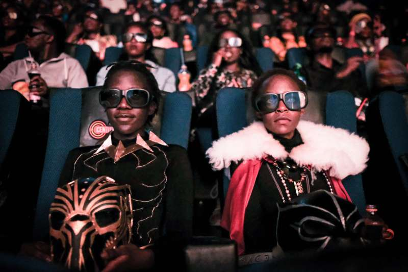 Cosplayers watches the film  Black Panther  in 3D which featuring Oscar-winning Mexico born Kenyan actress Lupita Nyongo during Movie Jabbers Black Panther Cosplay Screening in Nairobi, Kenya, on February 14, 2018.