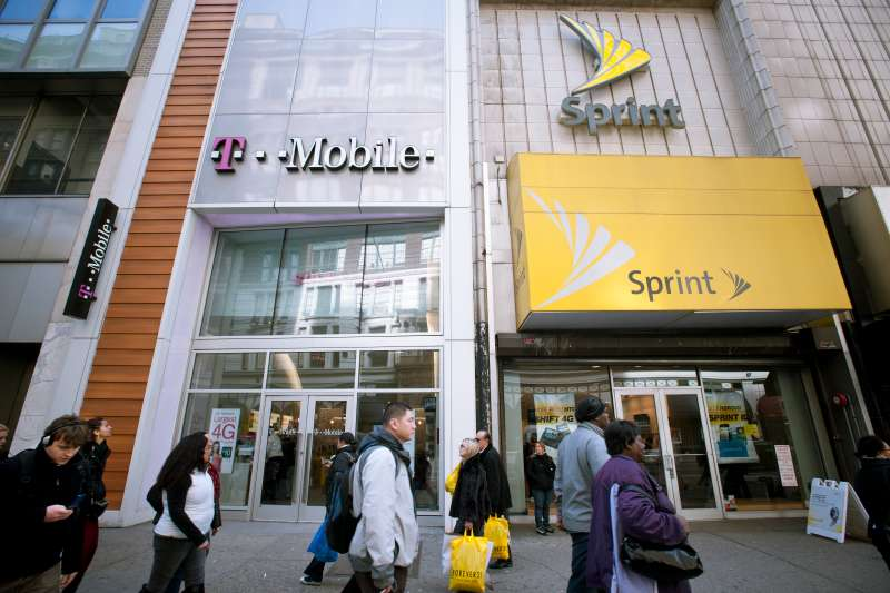 T-Mobile and Sprint Nextel cellular phone stores adjoin each other in Herald Square in New York on Tuesday, March 8, 2011.