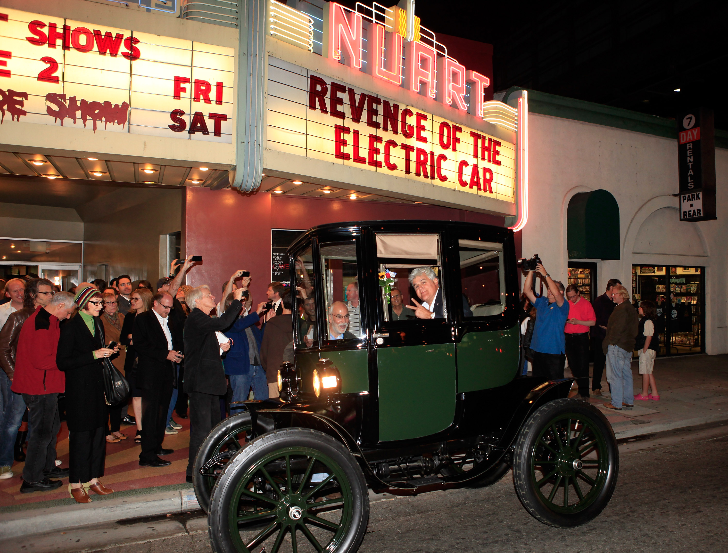 """Jay Leno arrives in his 1909 Baker Electric car at """"Revenge Of The Electric Car"""" Premiere held at Landmark Nuart Theatre on October 21, 2011 in Los Angeles, California."""