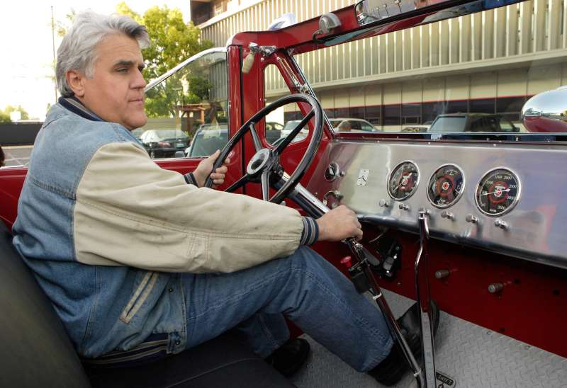 Host Jay Leno drives away in one of his many  automobiles,  a vintage collector red fire engine, after the show on April 16, 2007.