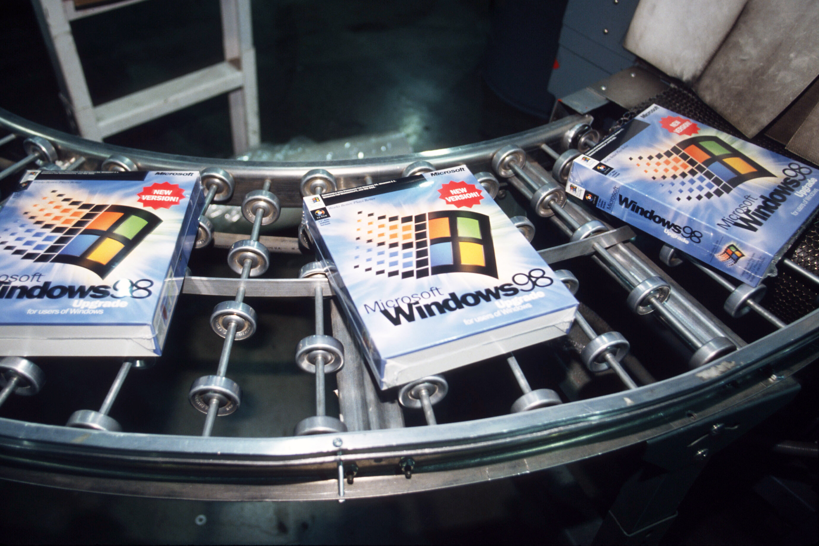 Windows 98 software packages sit on an assembly line June 24, 1998 in Bothell, WA.