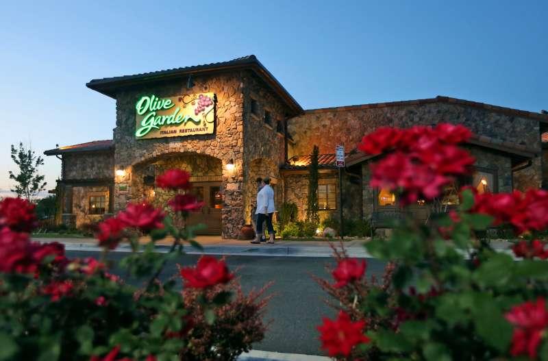 Patrons enter an Olive Garden Restaurant in Short Pump, Va.