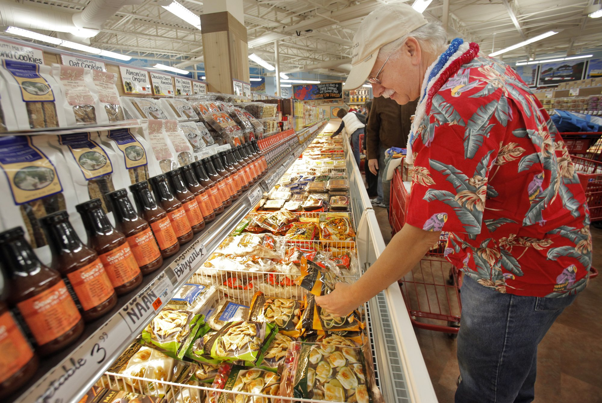 Michael Jubinsky of Lyman looks over a frozen food selection at the Trader Joe's in Portland on Fri