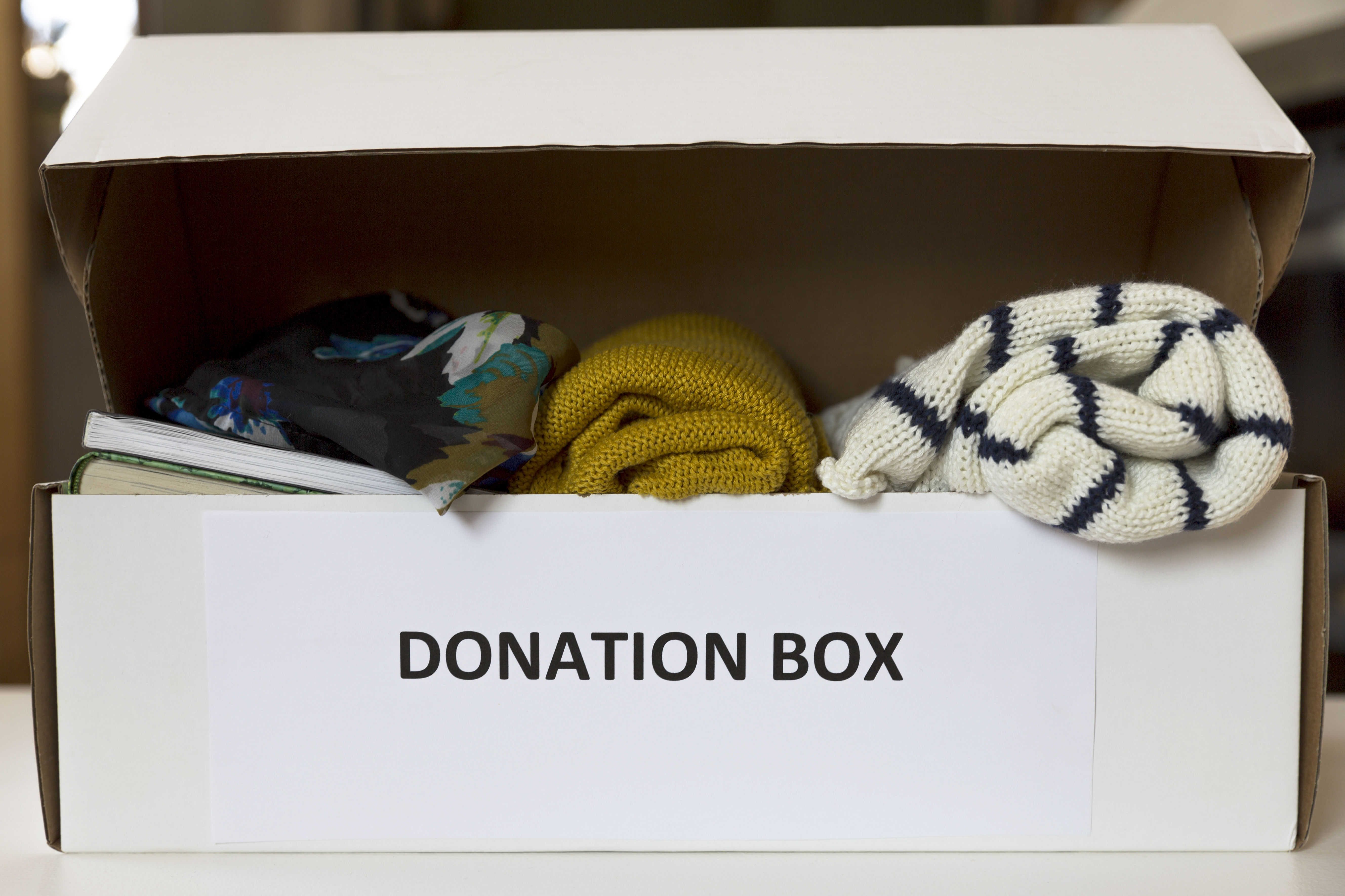 Donation box with clothes and books
