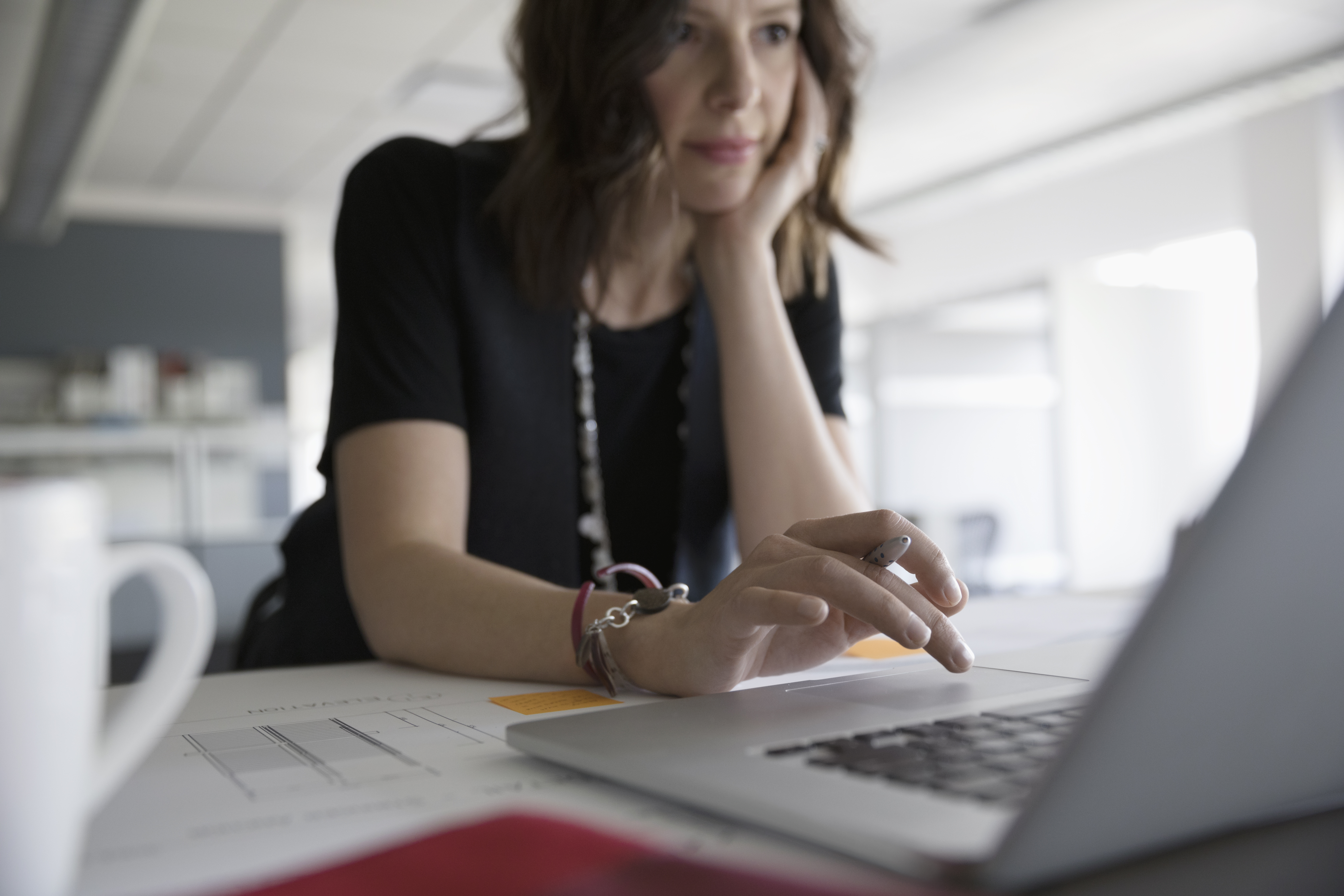 Female architect working at laptop in office