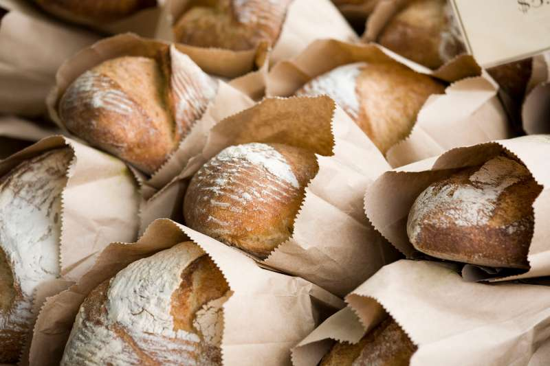 Loaves of fresh baked bread stacked high.  Check out my