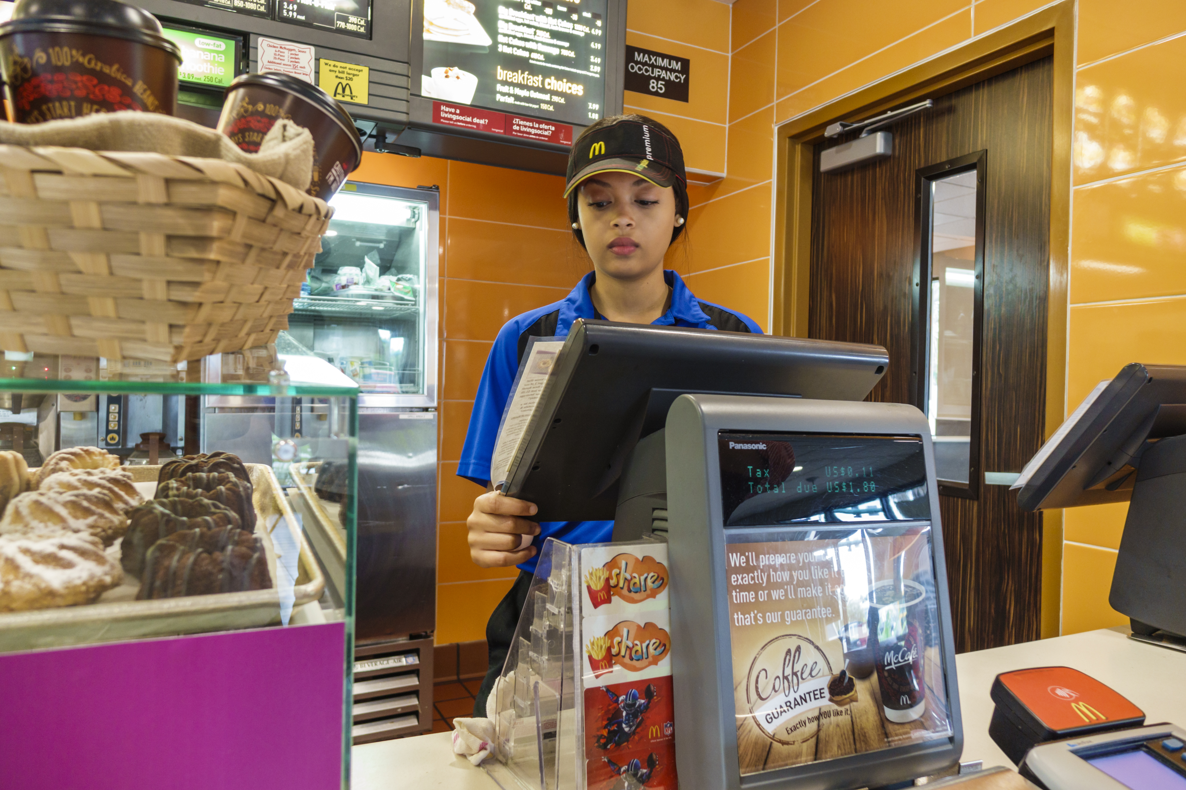 A woman employee at the counter in McDonald's.