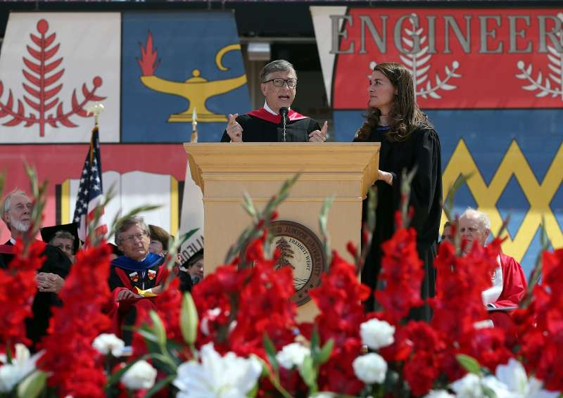 Microsoft founder and chairman Bill Gates speaks as his wife Melinda looks on during the 123rd Stanford University commencement ceremony in 2014.