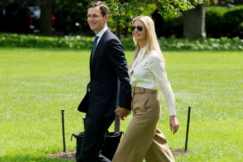 First daughter Ivanka Trump (R) and White House Senior Advisor Jared Kushner (L) walk across the South Lawn of the White House to join US President Donald J. Trump (not pictured) aboard Marine One en route to Camp David, in Washington, DC, June 1 2018.