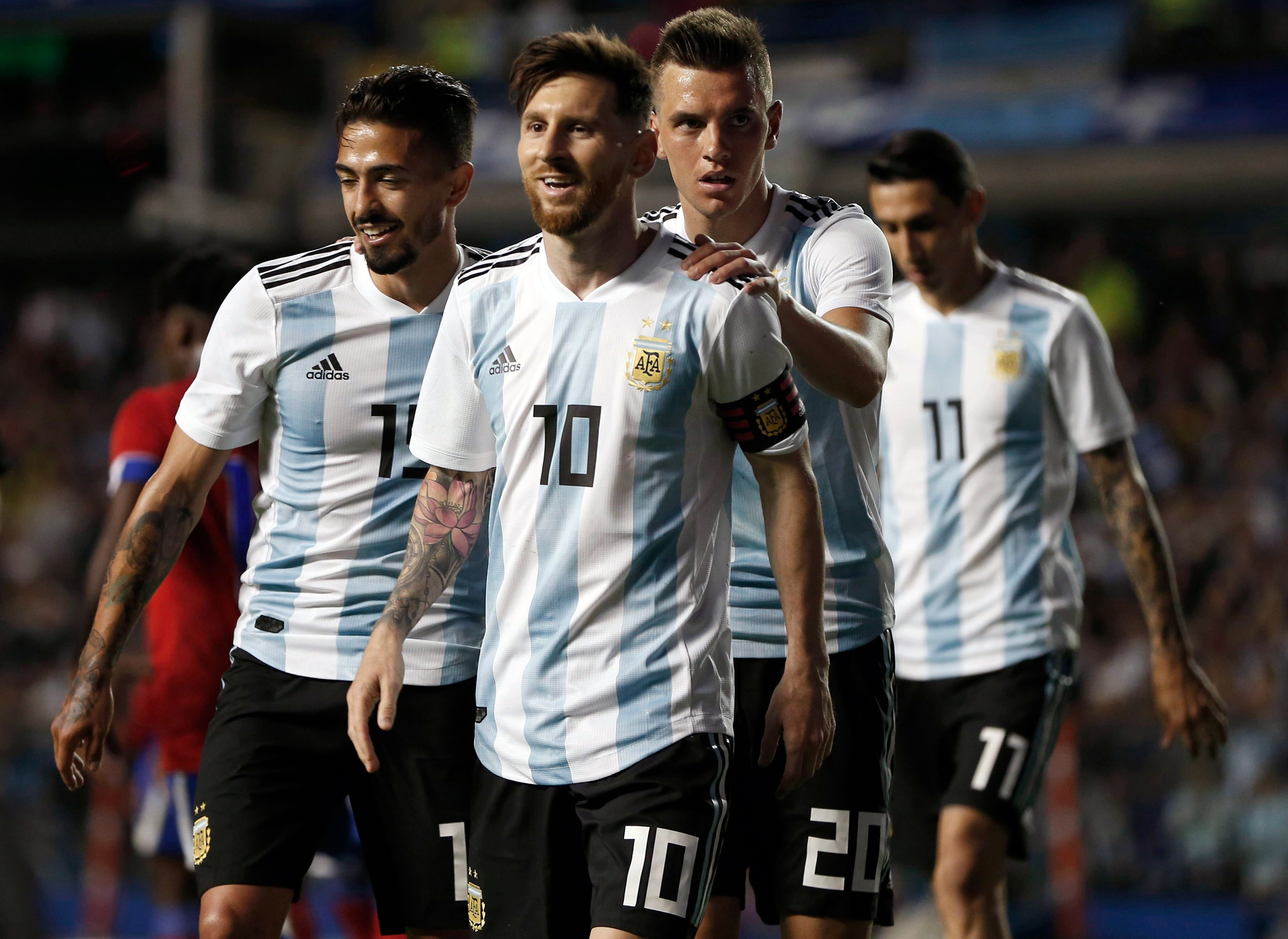 Argentina's Manuel Lanzini, left, Giovanni Lo Celso, second right, and Angel Di Maria, right, congratulate teammate Lionel Messi, second left, after his hat trick during a friendly soccer match between Argentina and Haiti at the Bombonera stadium in Buenos Aires, Argentina, May 29, 2018.