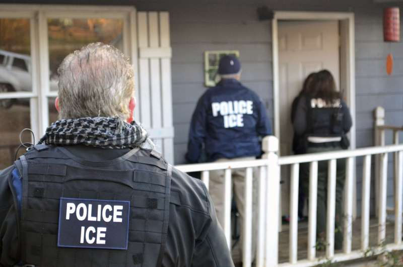 Provided U.S. Immigration and Customs Enforcement, ICE agents at a home in Atlanta, during a targeted enforcement operation aimed at immigration fugitives, re-entrants and at-large criminal aliens, February 9, 2017.
