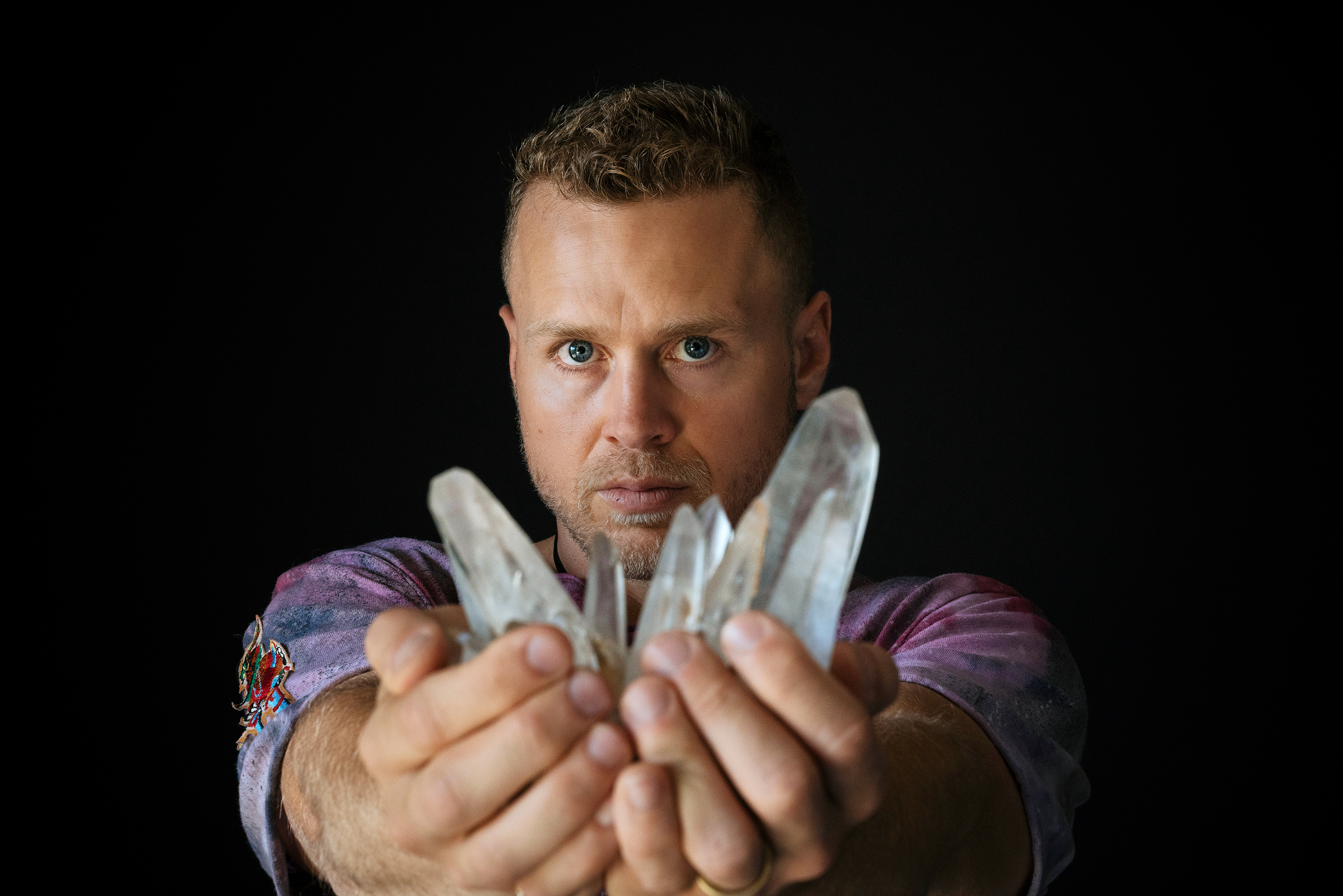 Spencer Pratt holds a lemurian quartz crystal from his collection at his home in the Pacific Palisades neighborhood of Los Angeles, California on Friday, June 22, 2018.