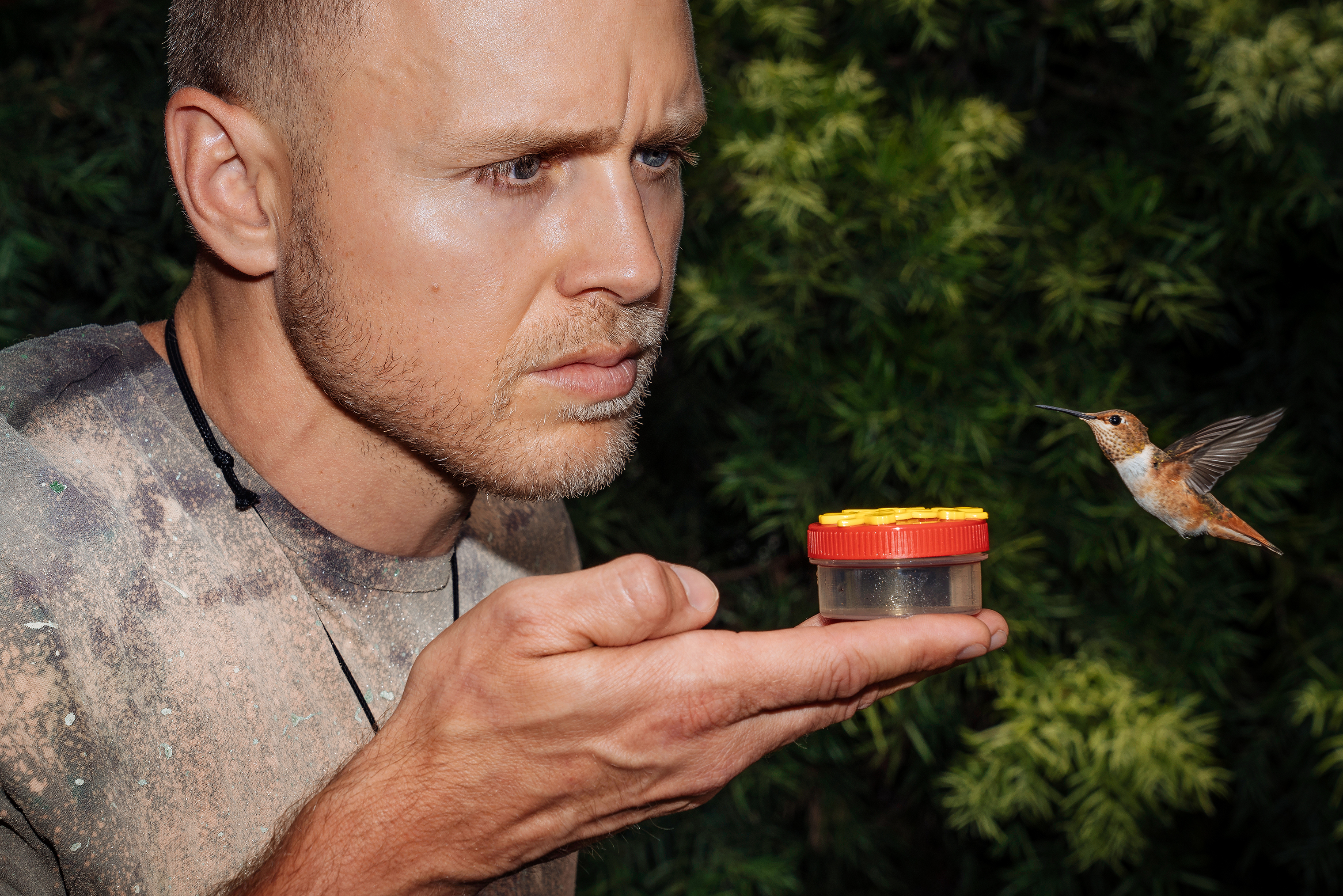 Spencer Pratt feeds hummingbirds at his home in the Pacific Palisades neighborhood of Los Angeles, California on Friday, June 22, 2018.