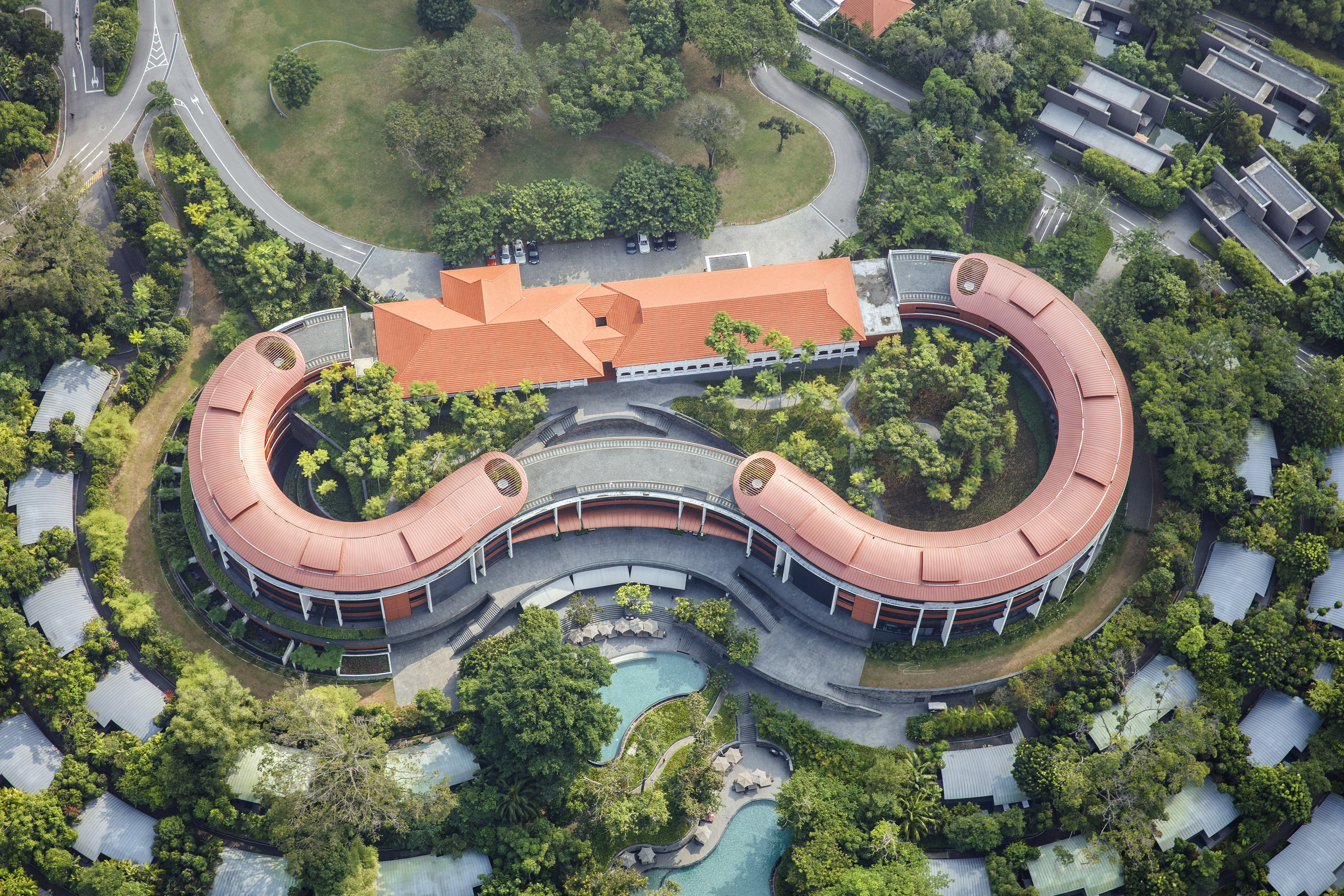 The Capella Singapore Hotel stands on Sentosa Island in this aerial photograph taken above Singapore, on Thursday, July 2, 2015. Singapore's economy contracted more than analysts predicted last quarter, underscoring the weakening outlook for Asian nations amid sluggish global growth. The local dollar weakened to its lowest level in more than a month. Photographer: Darren Soh/Bloomberg via Getty Images