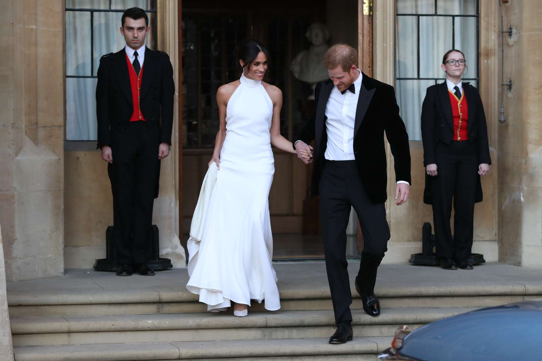 Duchess of Sussex and Prince Harry, Duke of Sussex leave Windsor Castle after their wedding to attend an evening reception at Frogmore House, hosted by the Prince of Wales on May 19, 2018 in Windsor, England.