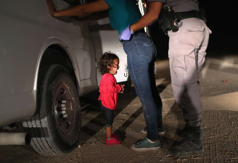 A two-year-old Honduran asylum seeker cries as her mother is searched and detained near the U.S.-Mexico border on June 12, 2018 in McAllen, Texas. The asylum seekers had rafted across the Rio Grande from Mexico and were detained by U.S. Border Patrol agents before being sent to a processing center for possible separation. Customs and Border Protection (CBP) is executing the Trump administration's  zero tolerance  policy towards undocumented immigrants. U.S. Attorney General Jeff Sessions also said that domestic and gang violence in immigrants' country of origin would no longer qualify them for political asylum status.