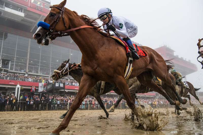 Justify, #7, ridden by jockey Mike Smith, wins the Preakness Stakes at Pimlico Race Course on May 19, 2018 in Baltimore, Maryland.