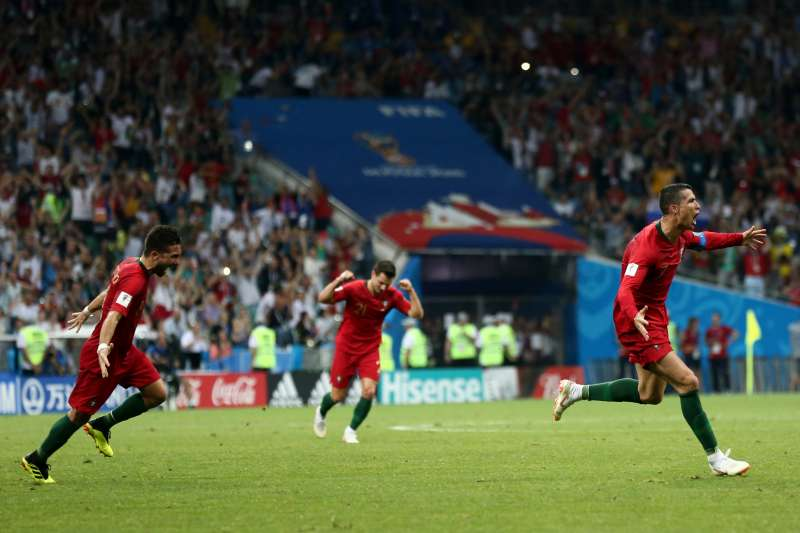 Cristiano Ronaldo #7 of Portugal celebrates after scoring a goal against Spain at the 2018 FIFA World Cup in Russia.