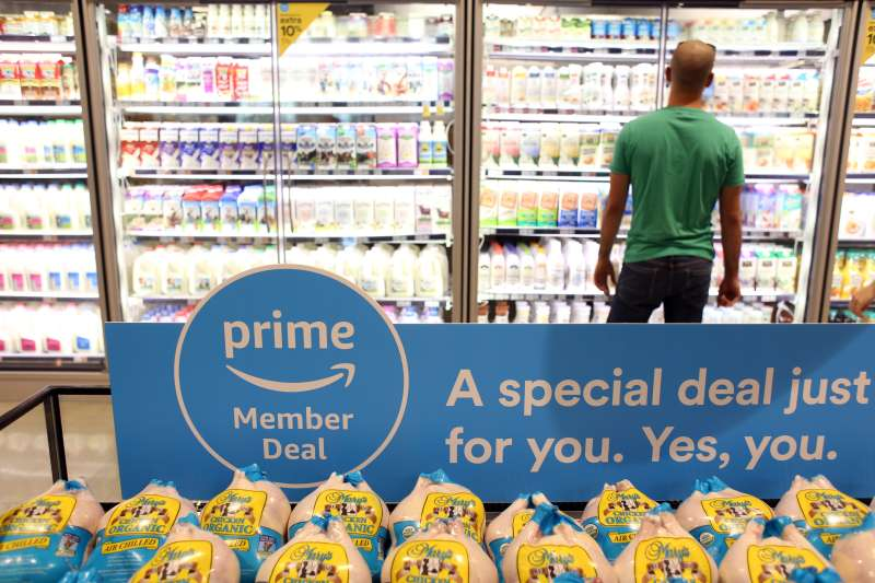 A sign alerts Amazon.com Inc. Prime members of a special deal on organic chickens during the grand opening of a Whole Foods Market Inc. location in Burbank, California, U.S., on Wednesday, June 20, 2018.