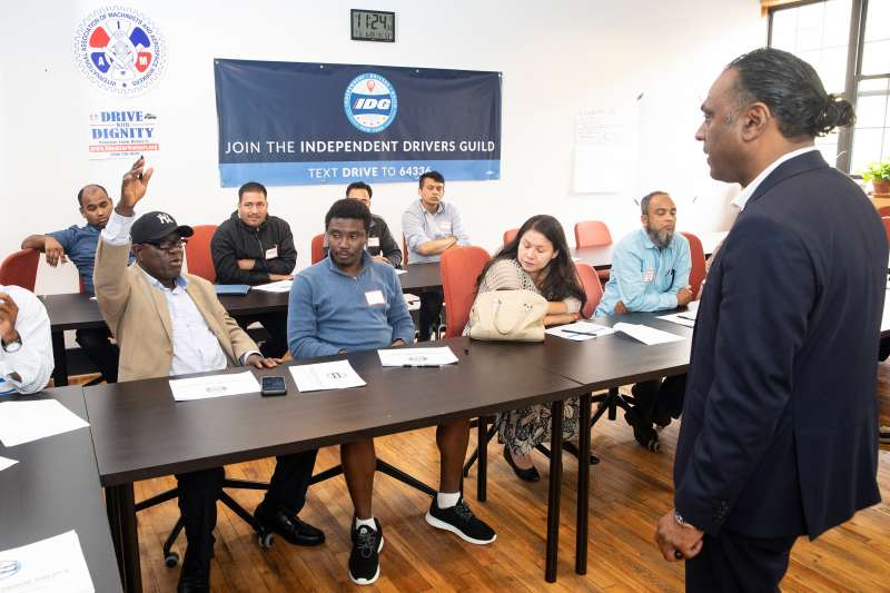 Nichodemus Obih, 65, asks a question at a five-star ratings class at the Independent Drivers Guild in Brooklyn, NY.