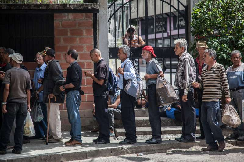 Venezuelan wait in a food distribution long queue in Caracas, Venezula, on 23 November 2017
