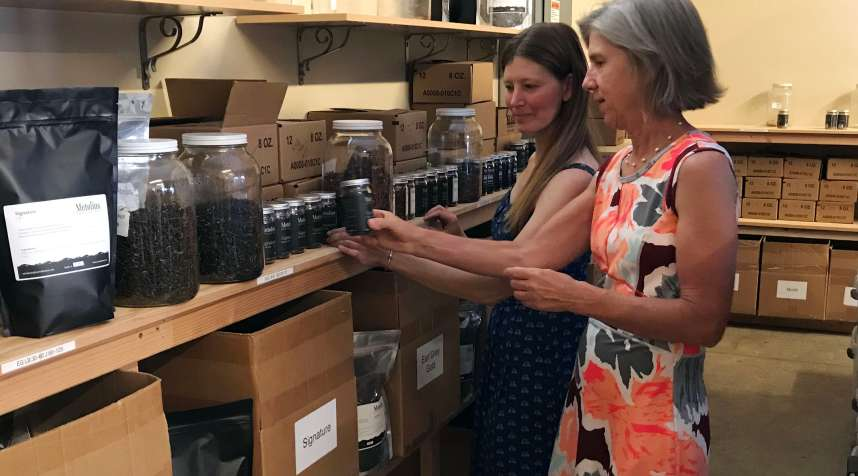 Leslie Cogswell, right, in Metolius's tea laboratory.