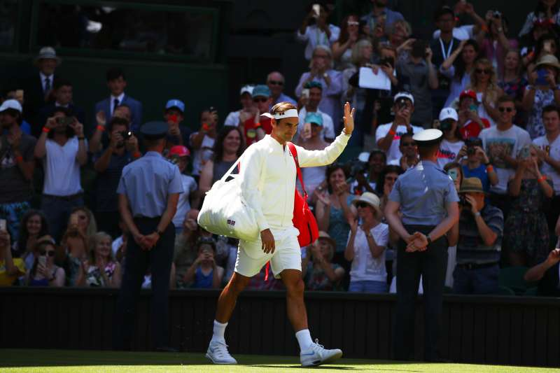Roger Federer of Switzerland walks out onto the court ahead of his Men's Singles first round match against Dusan Lajovic of Serbia on day one of the Wimbledon Lawn Tennis Championships at All England Lawn Tennis and Croquet Club on July 2, 2018 in London, England.