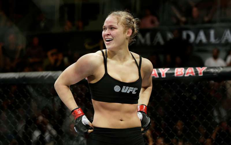 Ronda Rousey looks around after defeating Sara McMann in a UFC 170 mixed martial arts women's bantamweight title bout in Las Vegas.