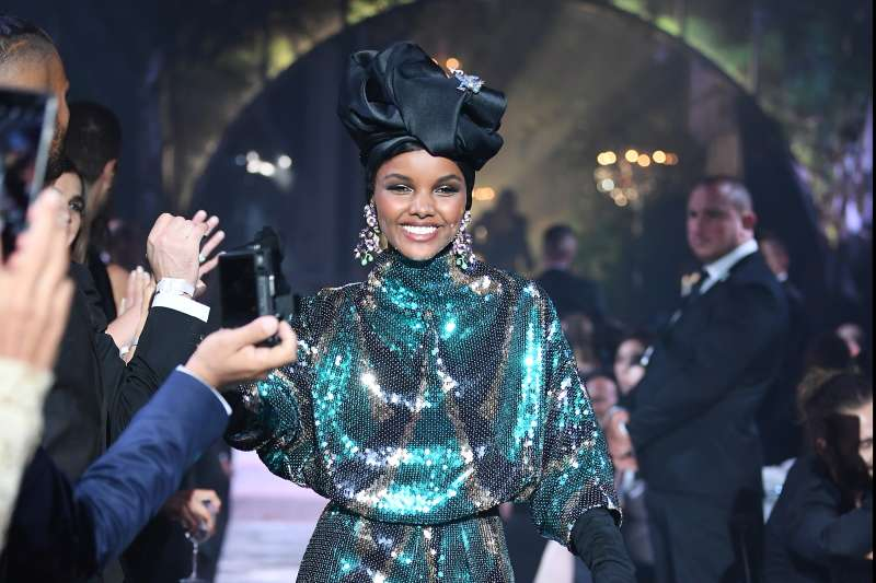Halima Aden wearing Marc Jacobs walks the runway at the amfAR Gala Cannes 2018 at Hotel du Cap-Eden-Roc on May 17, 2018 in Cap d'Antibes, France.
