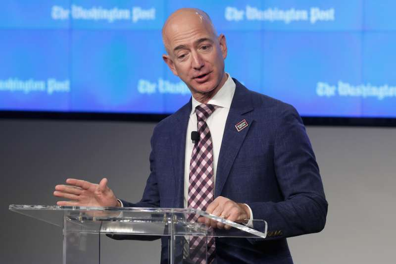 Amazon founder and Washington Post owner Jeff Bezos delivers remarks during the 2016 opening ceremony of the company's new location in Washington, D.C.