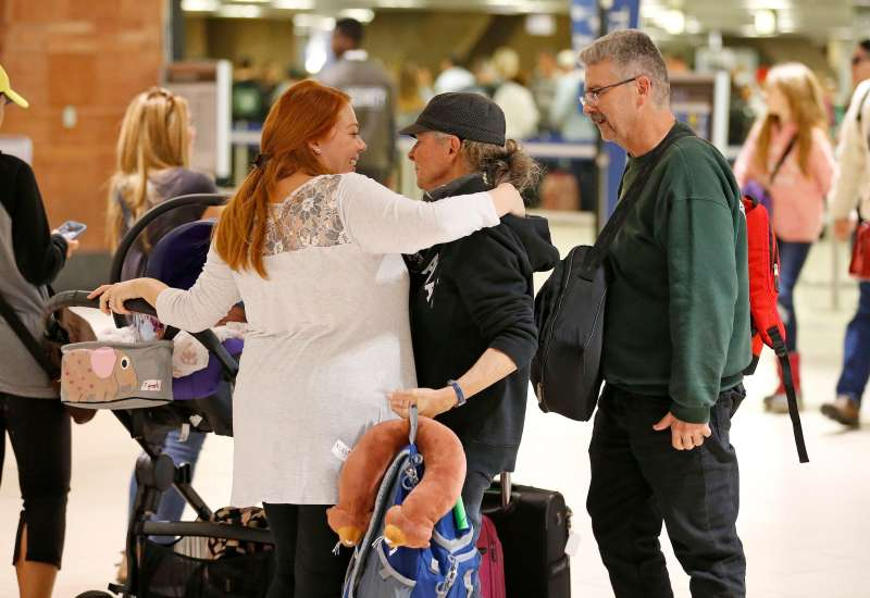 Family reuniting for the holidays at the airport