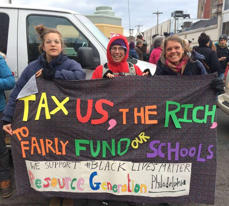 Kate Poole, left, marches with members of Resource Generation at a 2015 school funding protest in Philadelphia.