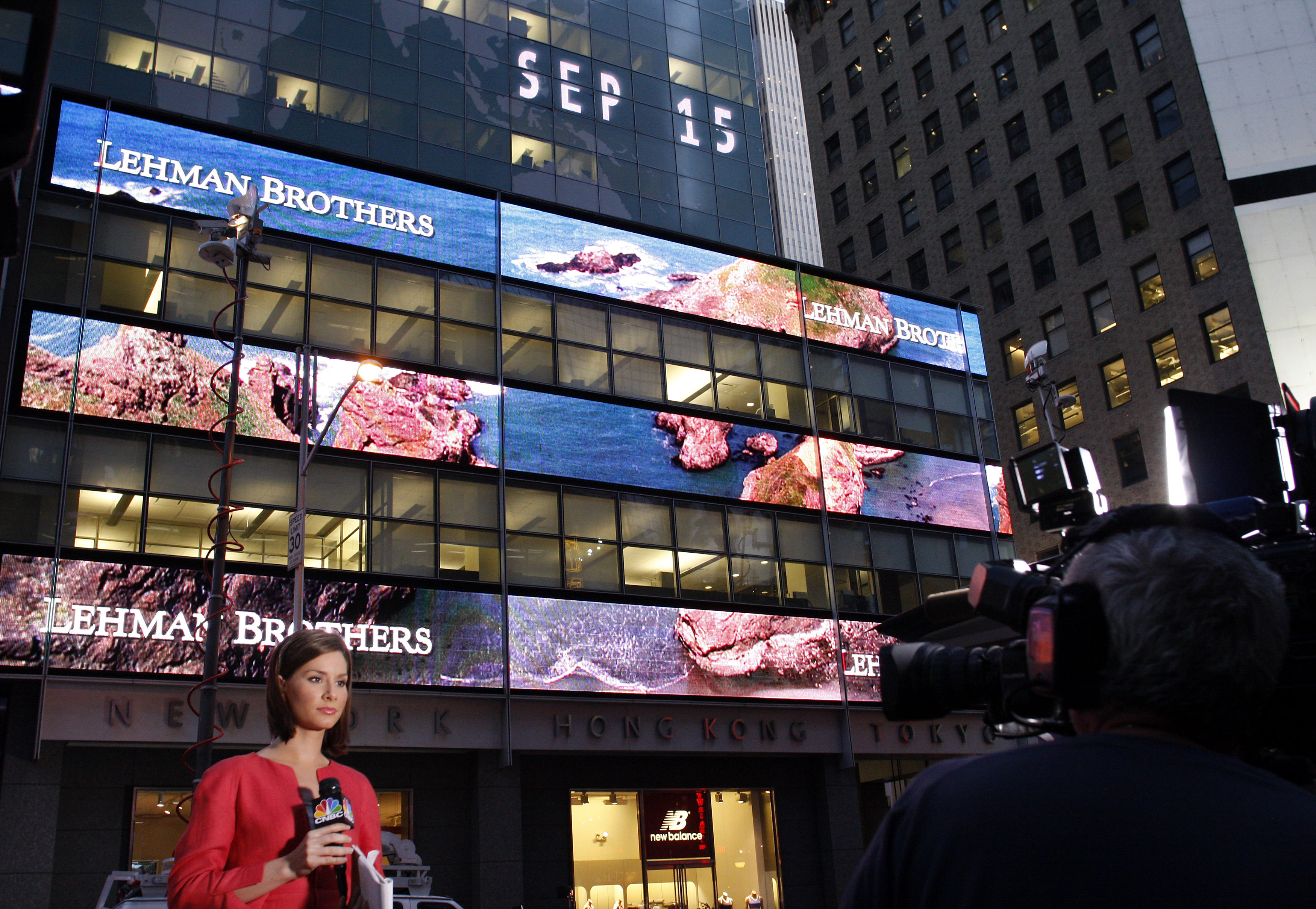 A journalist reports outside the Lehman Brothers building in New York, September 15, 2008.